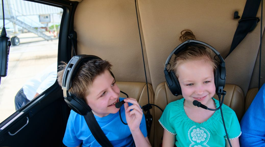 Kids at cabin of helicopter